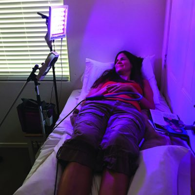 Patient on bed receiving dynamic light treatment